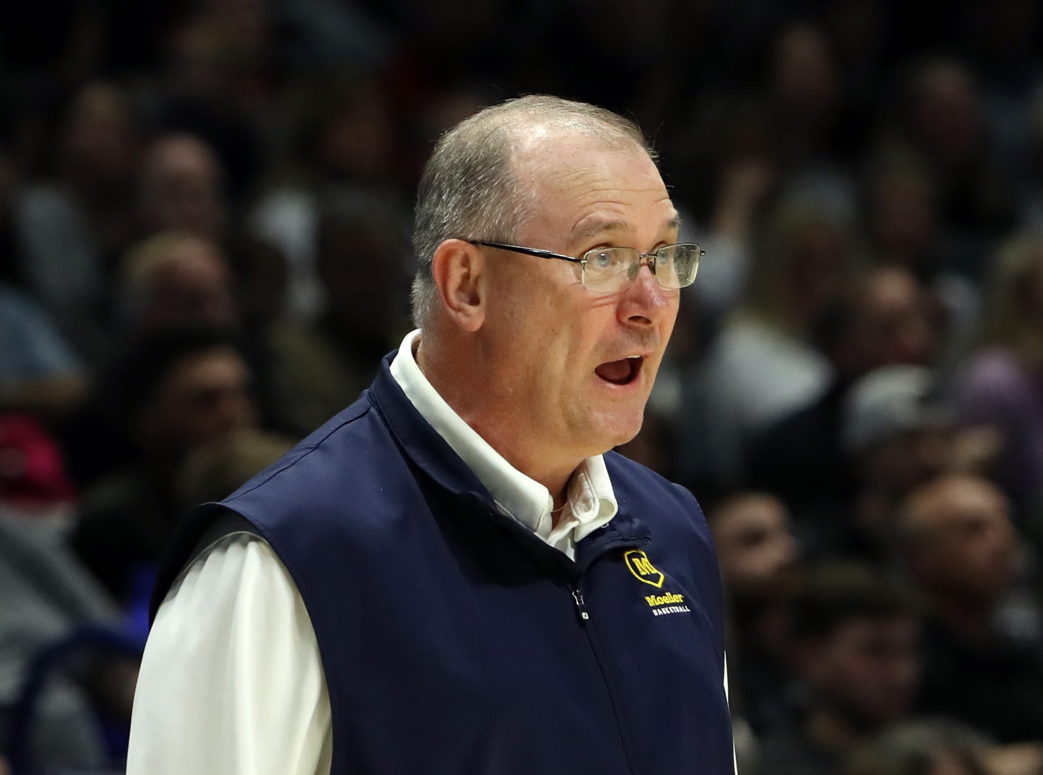 Moeller head coach Carl Kremer expresses his displeasure with his team in the second half of the boys regional semifinal March 13, 2019, at Xavier University's Cintas Center. Moeller defeated Lakota East 47-33.
