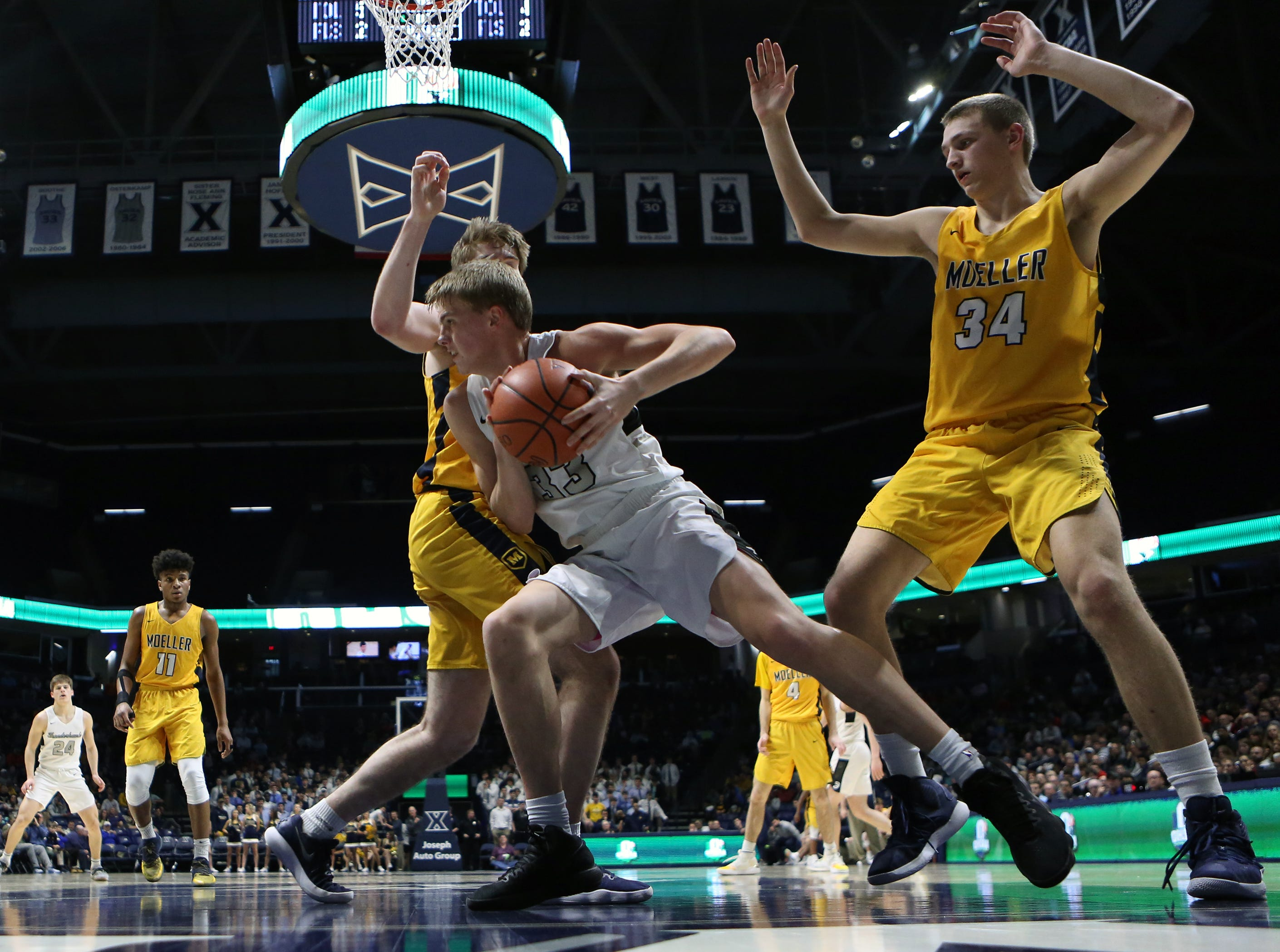 Lakota East forward Grant Spicer looks to score from the paint in the second half of the boys regional semifinal March 13, 2019, at Xavier University's Cintas Center. Moeller defeated Lakota East 47-33.