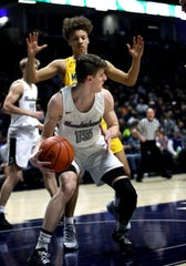 Lakota East guard Kaden Fuhrmann looks to pass in the boys regional semifinal March 13, 2019, at Xavier University's Cintas Center. Moeller defeated Lakota East 47-33.