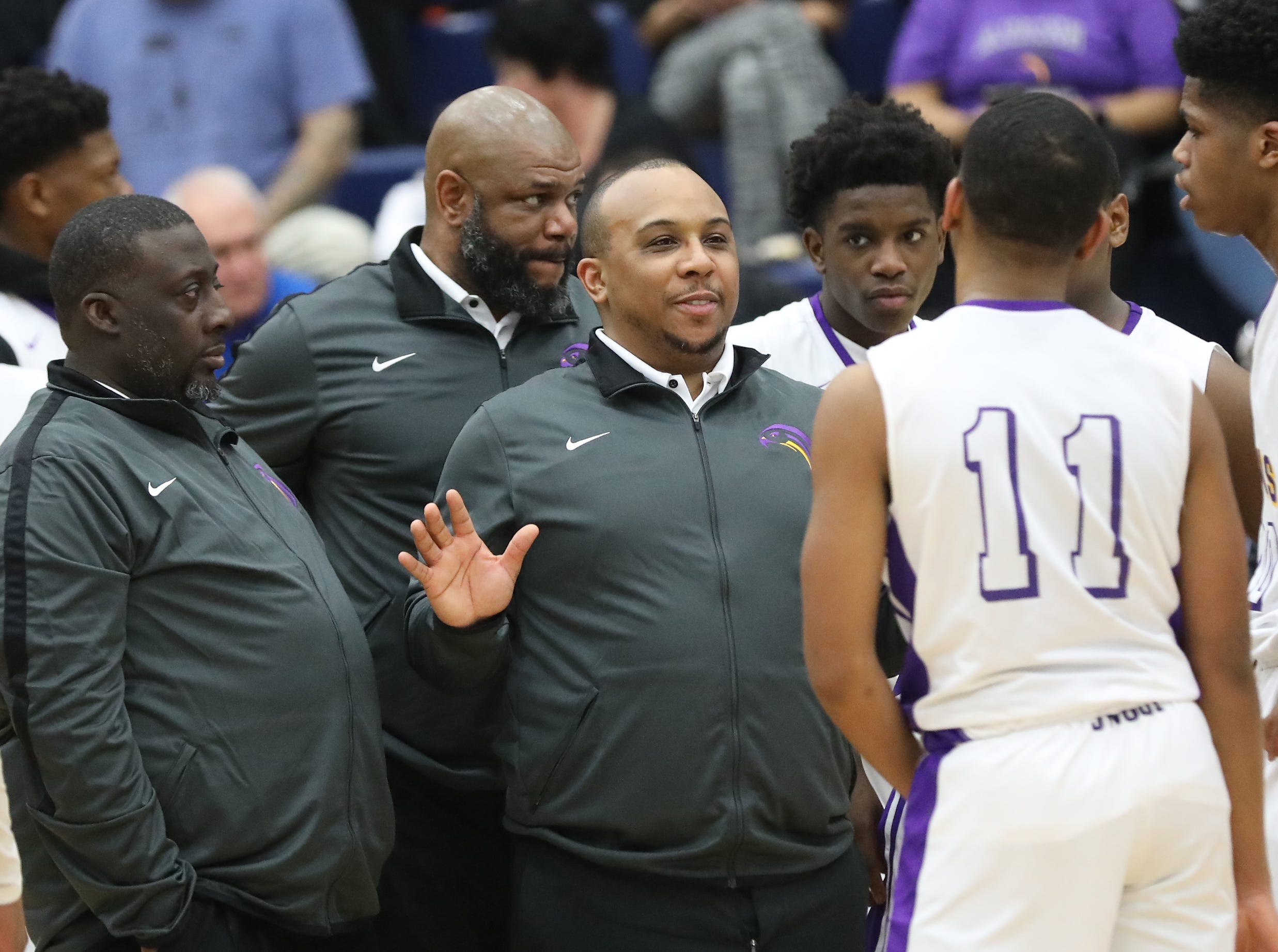 Aiken head coach Ty Cass talks to his team during the Falcons regional semifinal game against Trotwood Madison, Thursday, March 14, 2019.