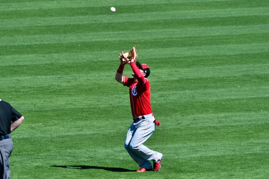 Cincinnati Reds second baseman Scooter Gennett (3) catches a fly ball during the third inning against the Los Angeles Dodgers at Camelback Ranch.