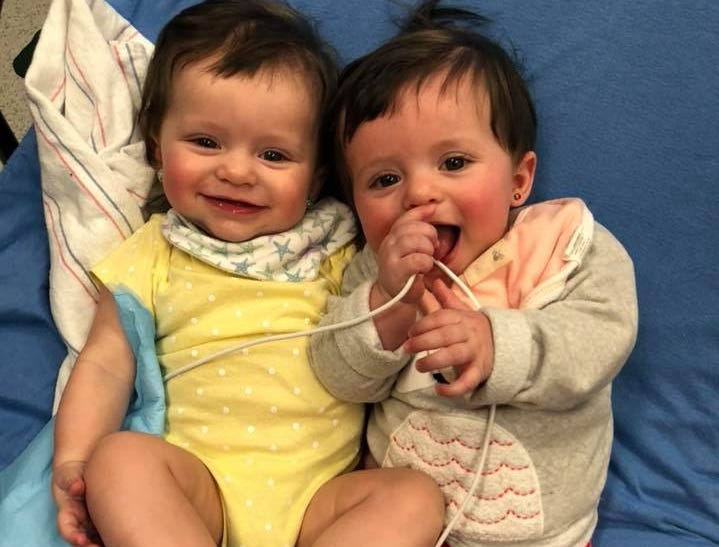 """The Pepin family of Sayreville has two of their three young children diagnosed with Retinoblastoma, a rare eye cancer. Eleven-month-old Lorelai — here with twin sister Autumn — was diagnosed at sixmonths and just finished her last chemotherapytreatment on Feb. 28.On March 23, Sayreville PBA Local #98 will host the """"Battle of the Borough"""" —abasketball gameto benefit the Pepins."""
