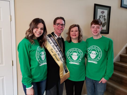 Ken Gardner, American Irish Association of Woodbridge, Irish Man of the Year pictured with daughter, Becca, wife, Janine and son, Kenny in shirts created by his daughter featuring Ken's image for this years parade