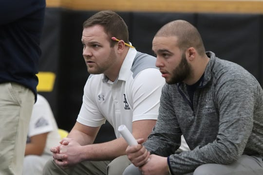 New Brunswick High School's Ben Ostner, left, is the Home News Tribune 2018-19 Wrestling Coach of the Year