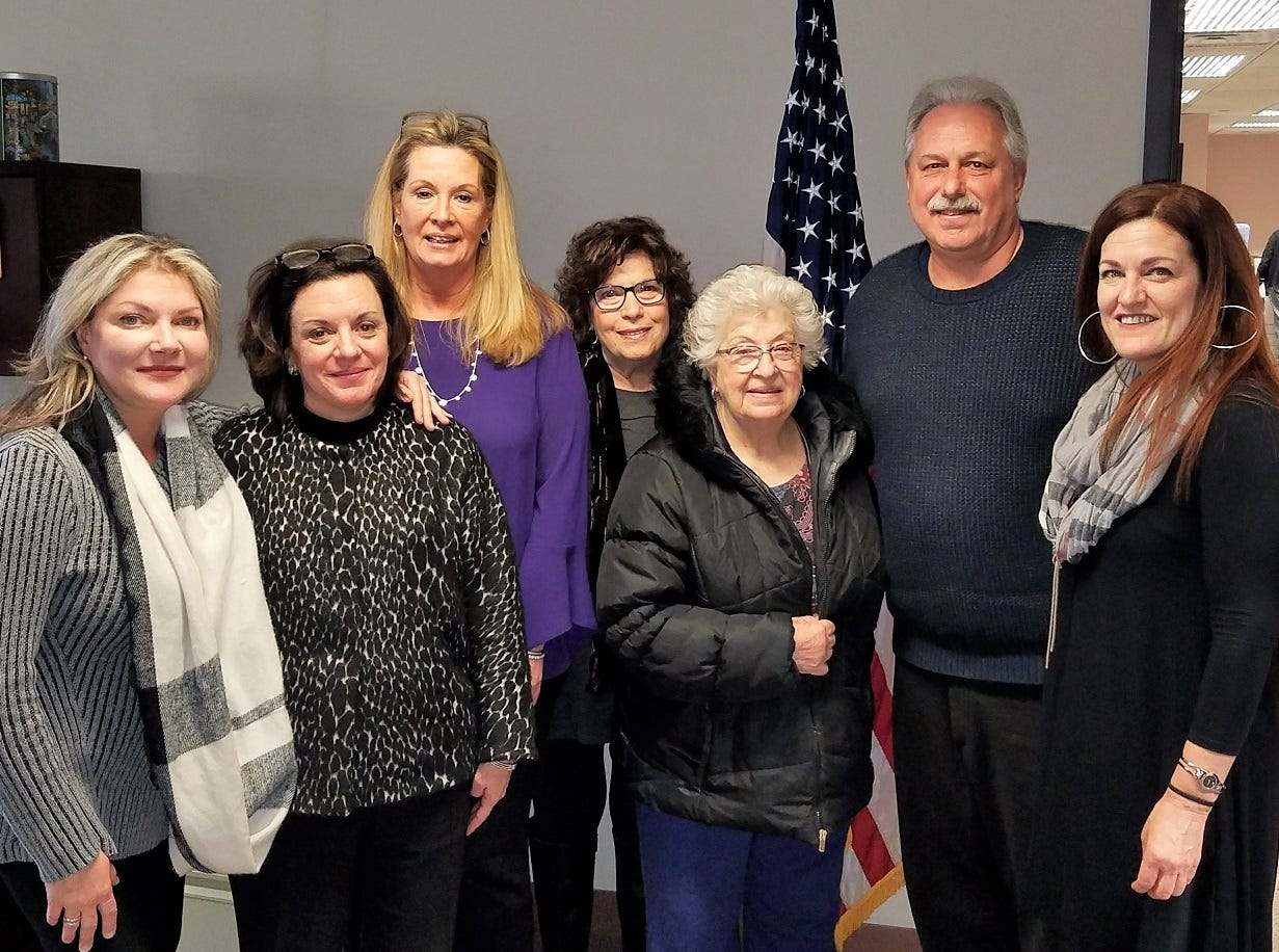 (Left to right)Leslie Stivale, Melissa Perilstein, Maureen Ruane, Ann Herterich, Carol Scardaci, Mayor Tom Lankey, and Deb Kaufman.
