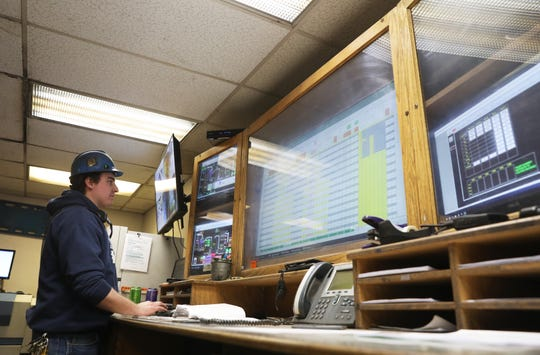 Garrett Albertson monitors the control center for the furnace at McWane Ductile in Coshocton.
