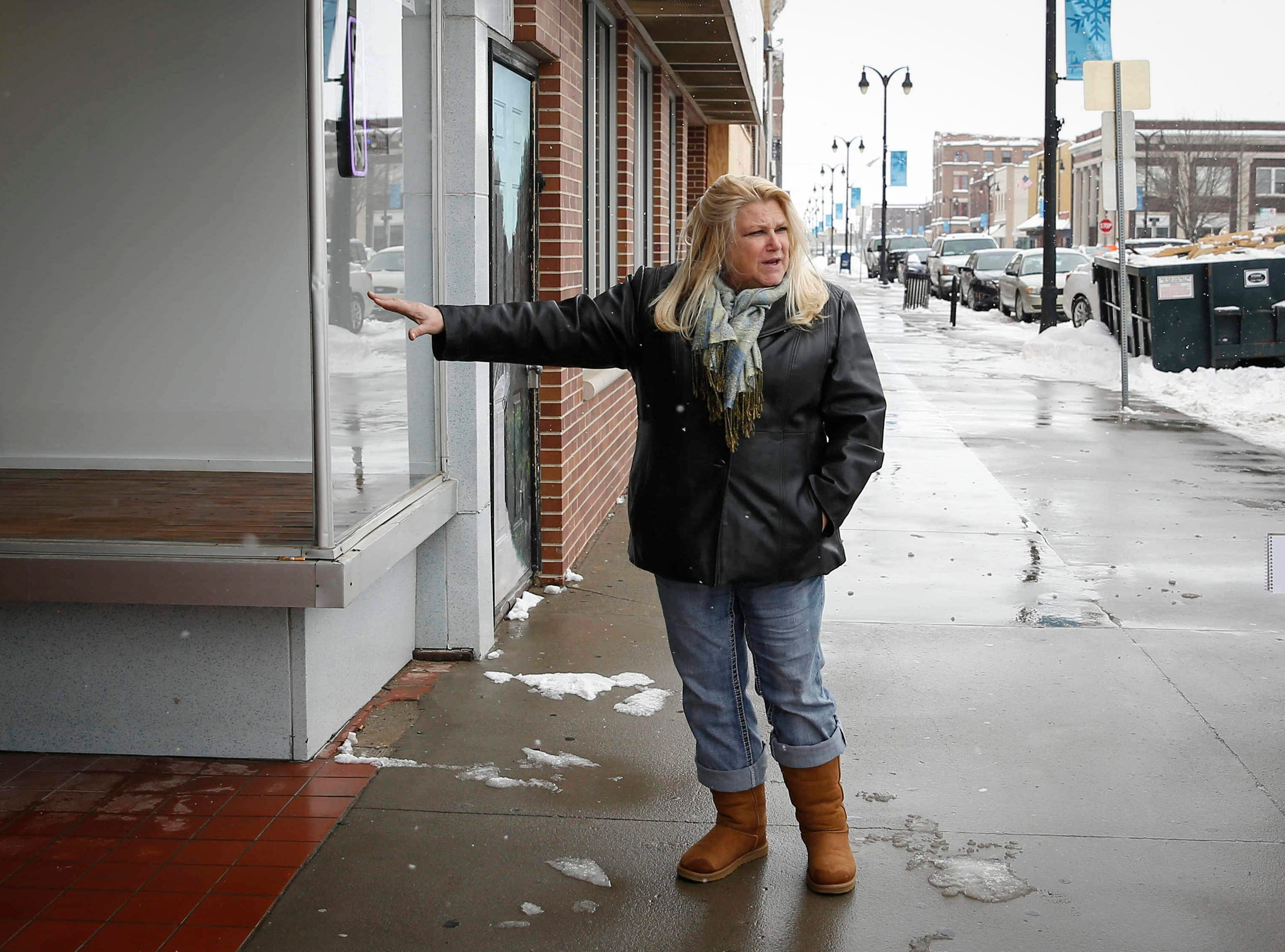 Jenny Etter, executive director of the Marshalltown Central Business District, gives a tour of Main Street on Wednesday, Feb. 20, 2019, in Marshalltown. On July 19, an EF-3 tornado ripped across downtown, toppling buildings and causing more than $1 million in property damage.