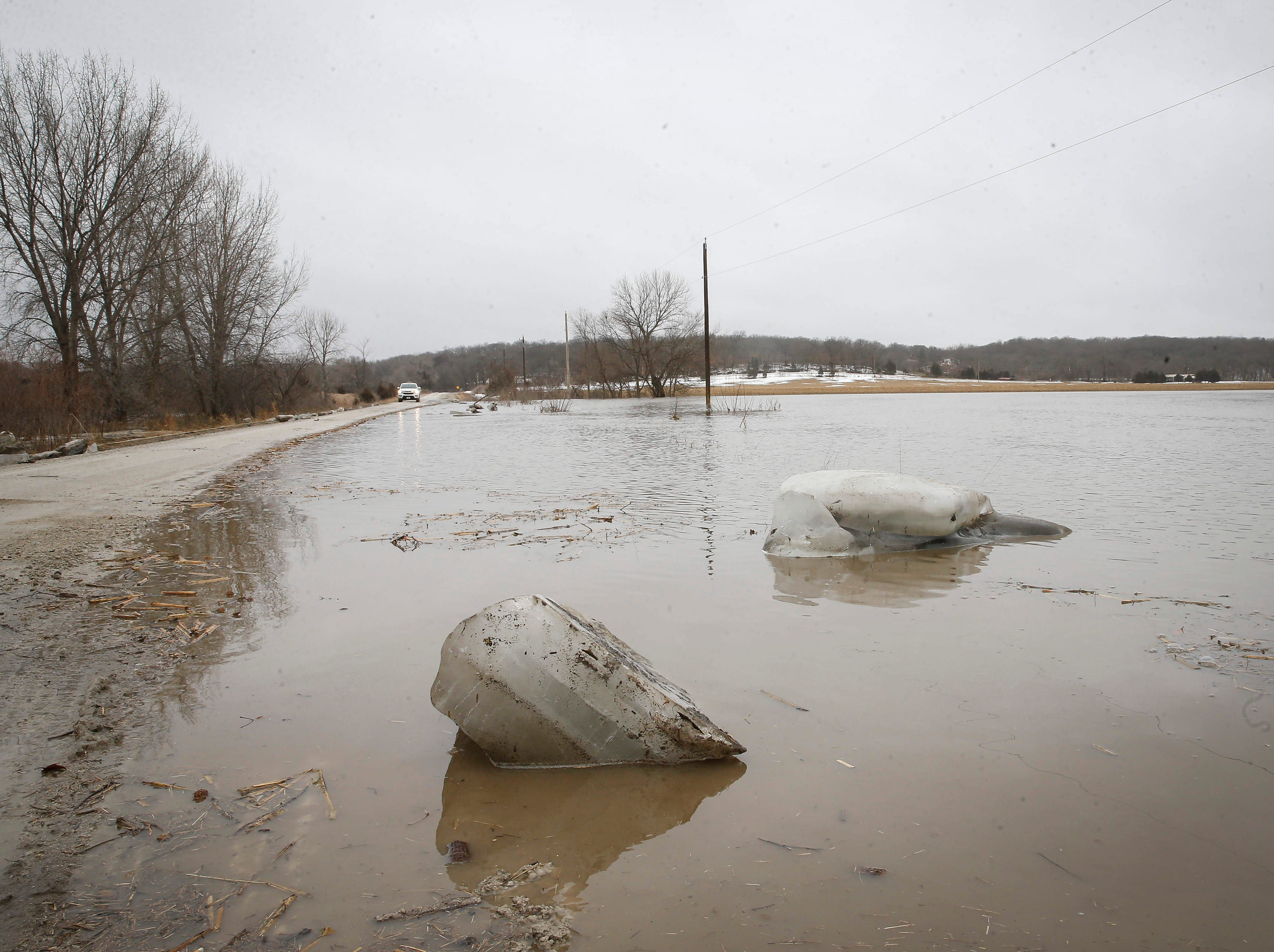 Large chunks of ice bob in the flooded water of the South Raccoon River near Redfield on Thursday, March 14, 2019. Flooding caused a portion of H Avenue to close as water flooded the road.