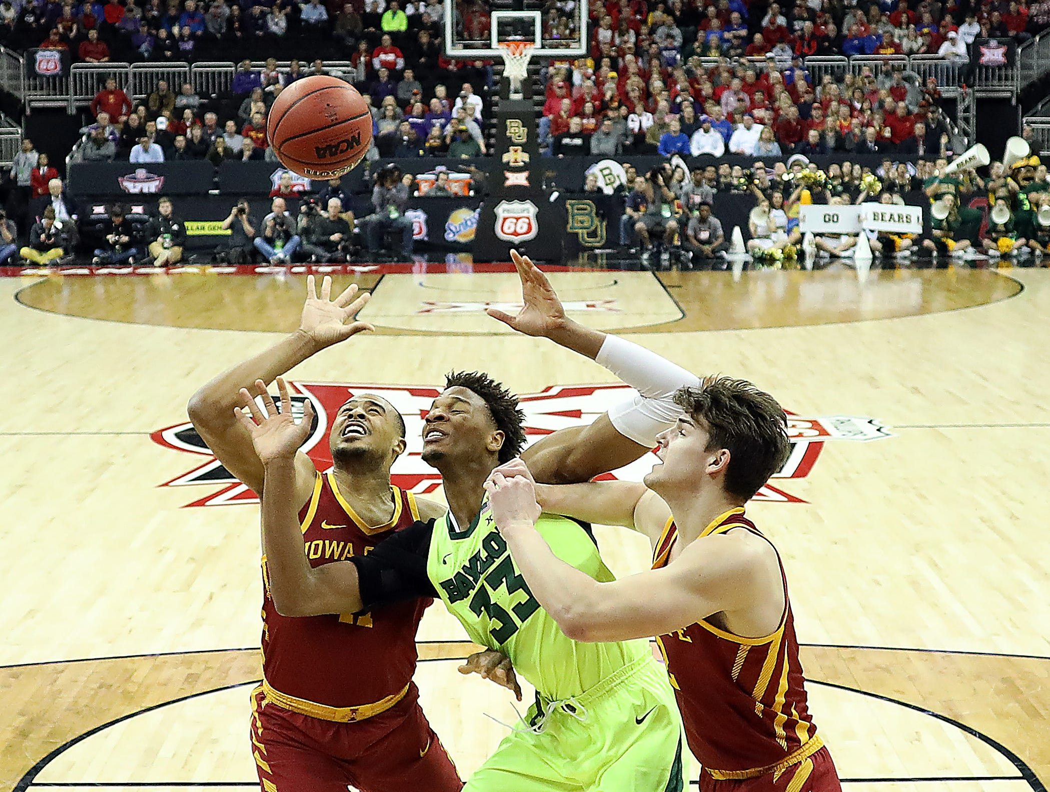 KANSAS CITY, MISSOURI - MARCH 14:  Freddie Gillespie #33 of the Baylor Bears battles Talen Horton-Tucker #11 and Michael Jacobson #12 of the Iowa State Cyclones for a rebound during the quarterfinal game of the Big 12 Basketball Tournament at Sprint Center on March 14, 2019 in Kansas City, Missouri. (Photo by Jamie Squire/Getty Images)