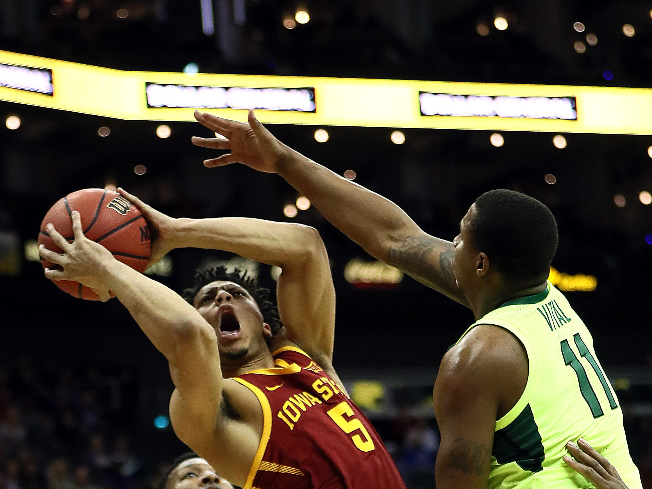 KANSAS CITY, MISSOURI - MARCH 14:  Lindell Wigginton #5 of the Iowa State Cyclones shoots as King McClure #3 and Mark Vital #11 of the Baylor Bears defend during the quarterfinal game of the Big 12 Basketball Tournament at Sprint Center on March 14, 2019 in Kansas City, Missouri. (Photo by Jamie Squire/Getty Images)