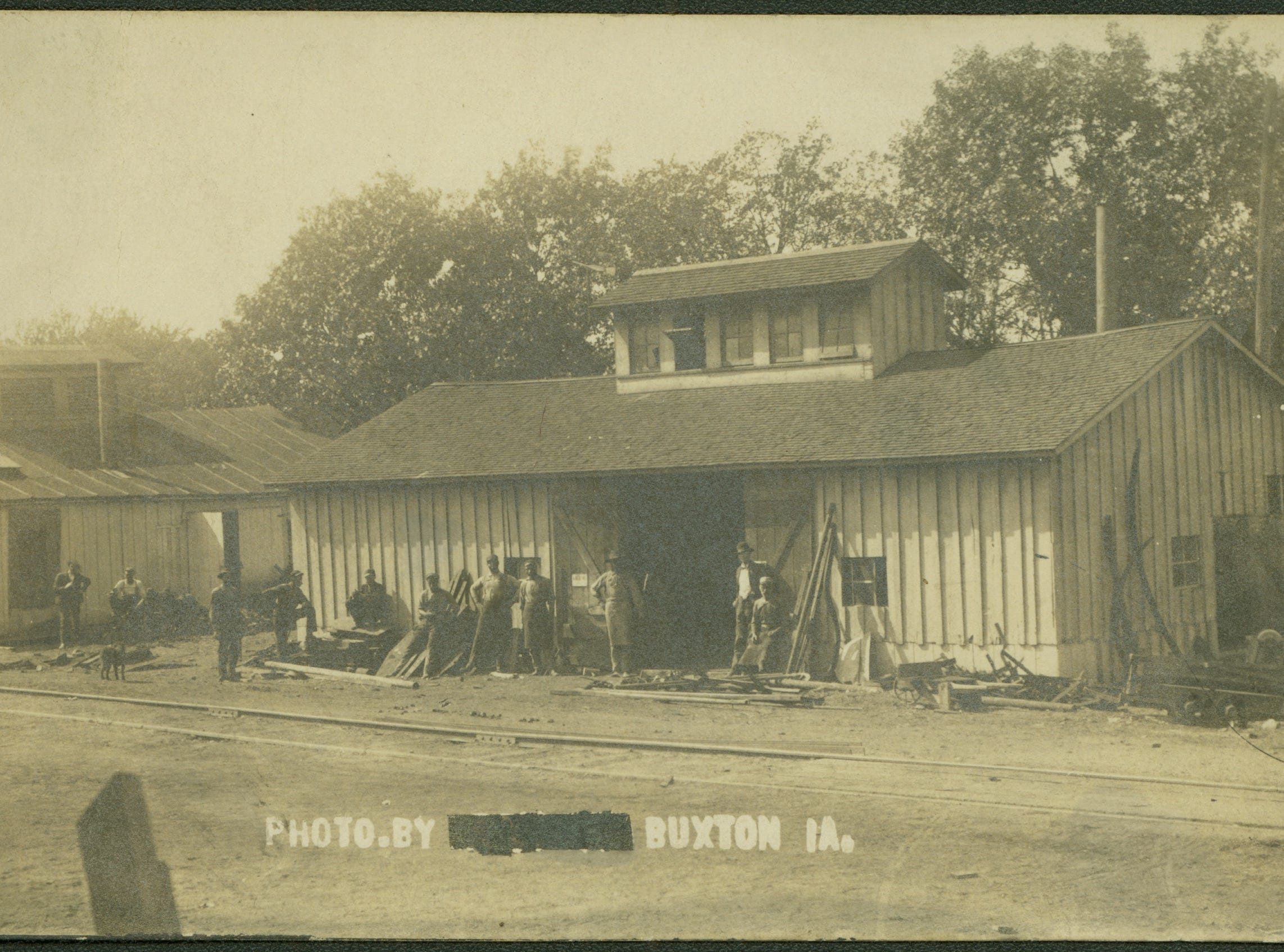 A blacksmith shop and its employees in Buxton, Iowa, in about 1905.