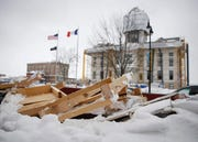 The Marshall County Courthouse is wrapped in scaffolding and construction debris is piled nearby as work continues on the structure Wednesday, Feb. 20, 2019, in Marshalltown. On July 19, an EF-3 tornado ripped across downtown, toppling buildings and causing millions in property damage.