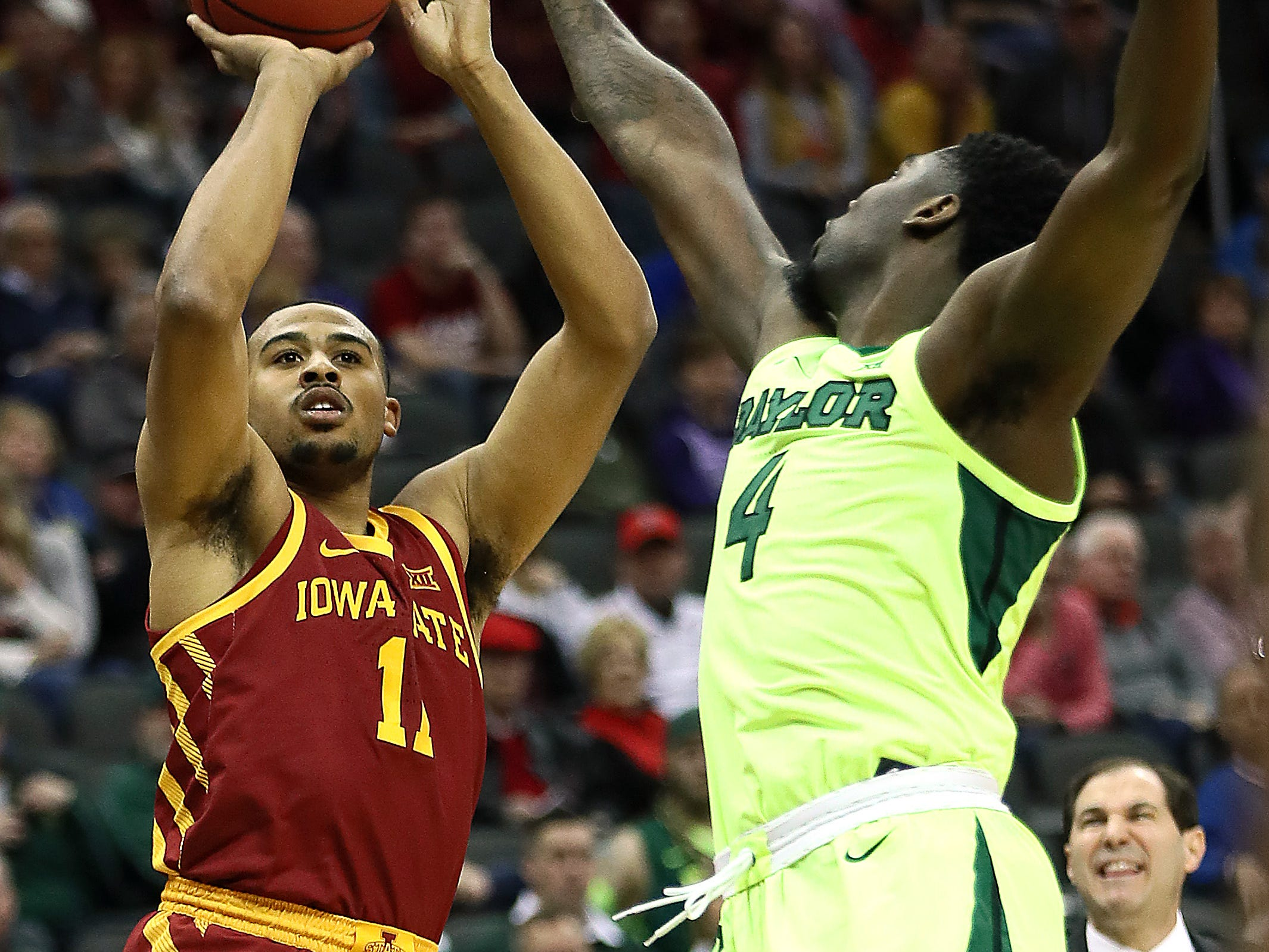 KANSAS CITY, MISSOURI - MARCH 14:  Talen Horton-Tucker #11 of the Iowa State Cyclones shoots over Mario Kegler #4 of the Baylor Bears during the quarterfinal game of the Big 12 Basketball Tournament at Sprint Center on March 14, 2019 in Kansas City, Missouri. (Photo by Jamie Squire/Getty Images)
