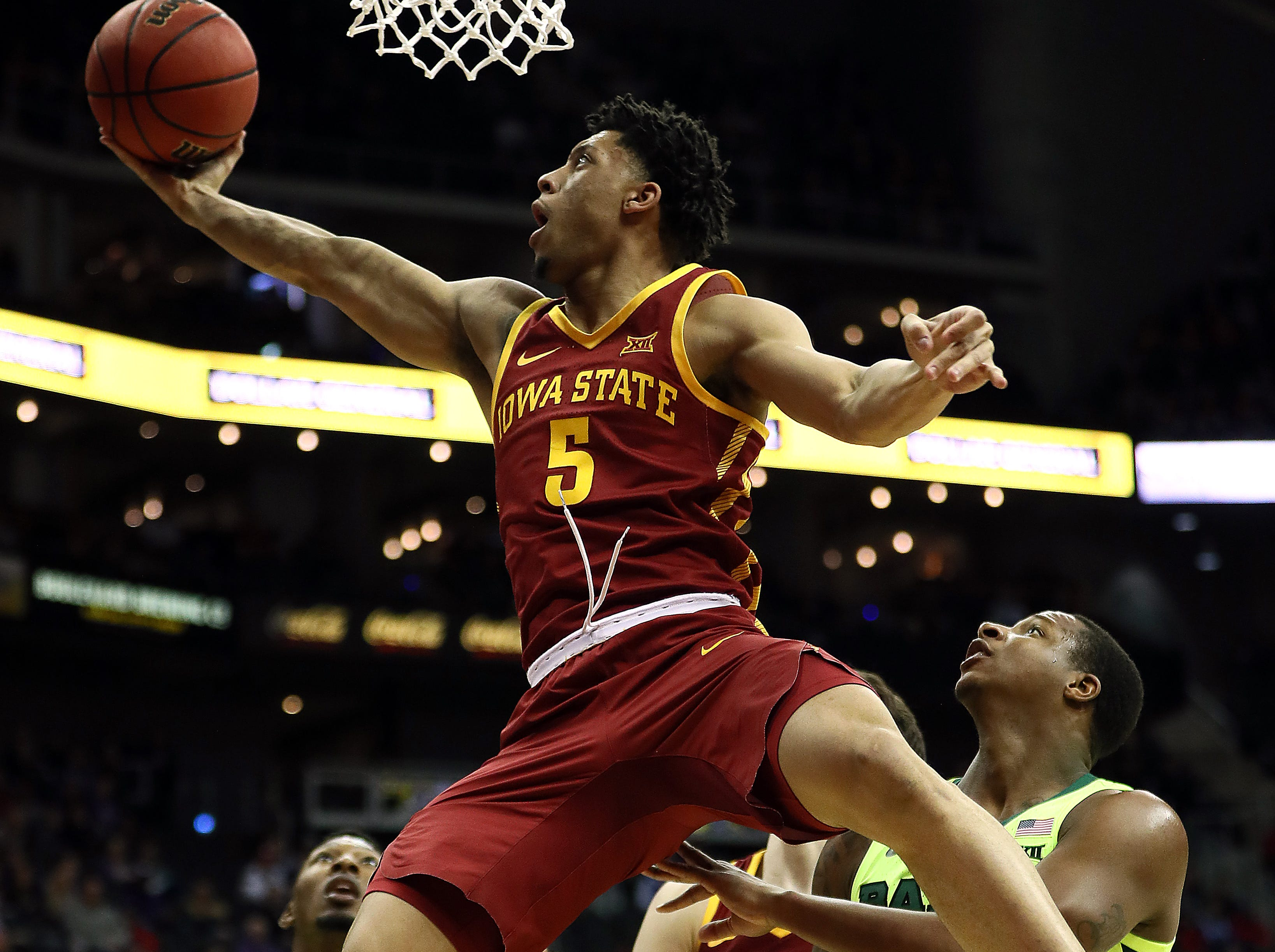 KANSAS CITY, MISSOURI - MARCH 14:  Lindell Wigginton #5 of the Iowa State Cyclones drives toward the basket during the quarterfinal game of the Big 12 Basketball Tournament against the Baylor Bears at Sprint Center on March 14, 2019 in Kansas City, Missouri. (Photo by Jamie Squire/Getty Images)