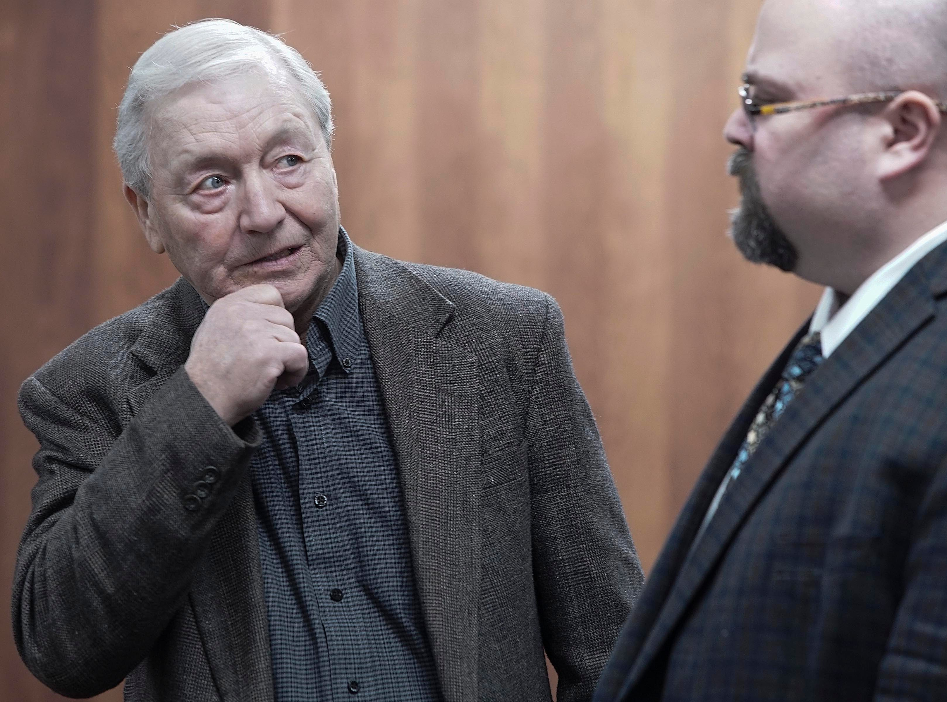 Bill Carter, 73, of Lacona, Iowa, talks with Marion County Attorney Ed Bull on Thursday, March 14, 2019, at the murder trial of his son, Jason Carter, at the Pottawattamie County Courthouse in Council Bluffs. Jason Carter is accused of fatally shooting his mother, Shirley Carter, in 2015 at the farm where she and Bill Carter lived.
