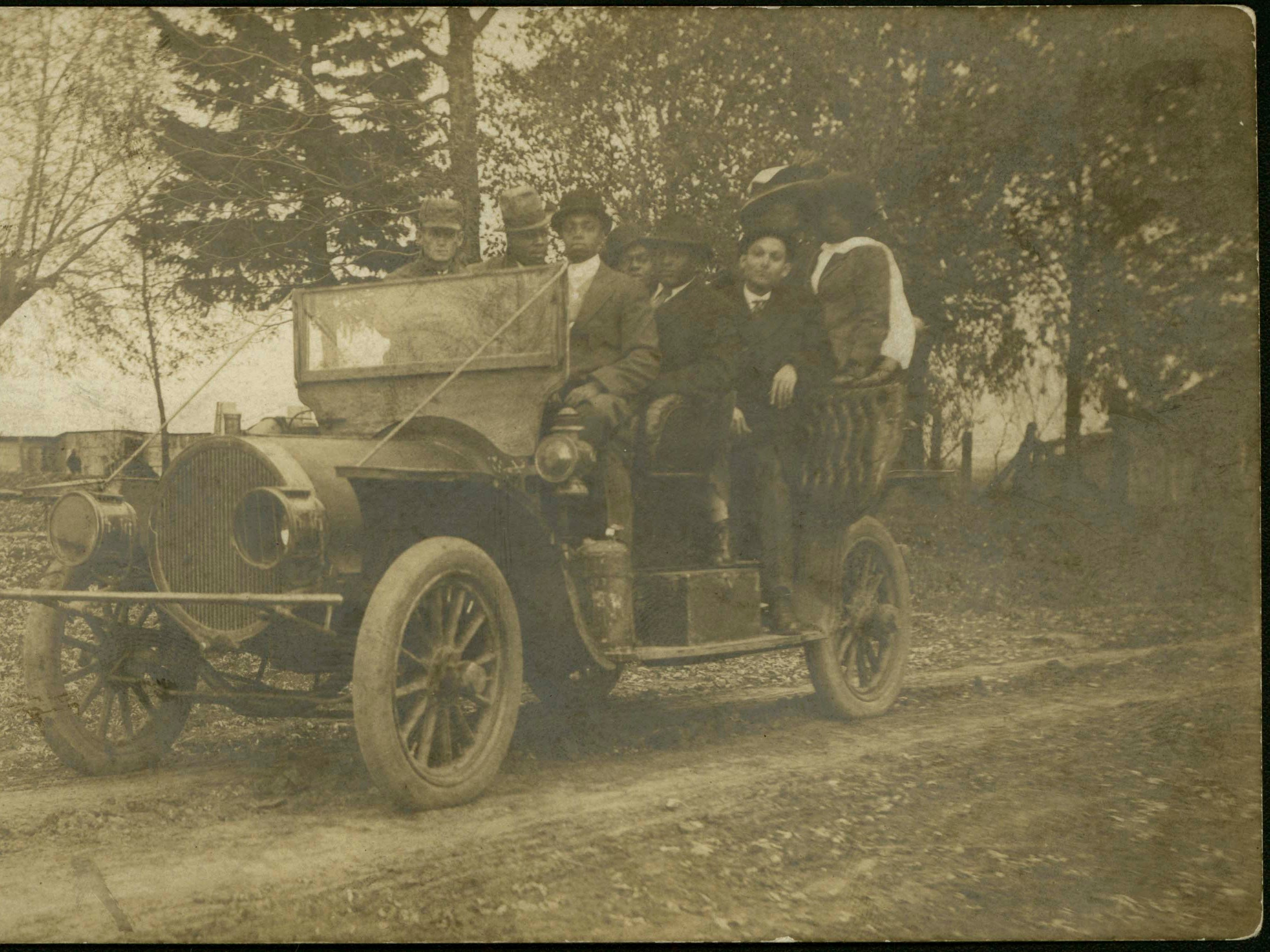 Residents of Buxton in a Reo automobile, about 1910.
