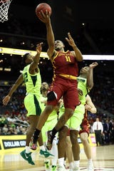 KANSAS CITY, MISSOURI - MARCH 14:  Talen Horton-Tucker #11 of the Iowa State Cyclones shoots as Jared Butler #12 of the Baylor Bears defends during the quarterfinal game of the Big 12 Basketball Tournament at Sprint Center on March 14, 2019 in Kansas City, Missouri. (Photo by Jamie Squire/Getty Images)