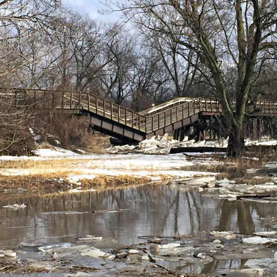 """The Trestle Trail Bridge in Johnston collapsed Wednesday after ice jams from Beaver Creek collected around the bridge supports. One of the bridge's main supports appears to have been """"structurally compromised,"""" said Rich Leopold, director of the Polk County Conservation Board."""