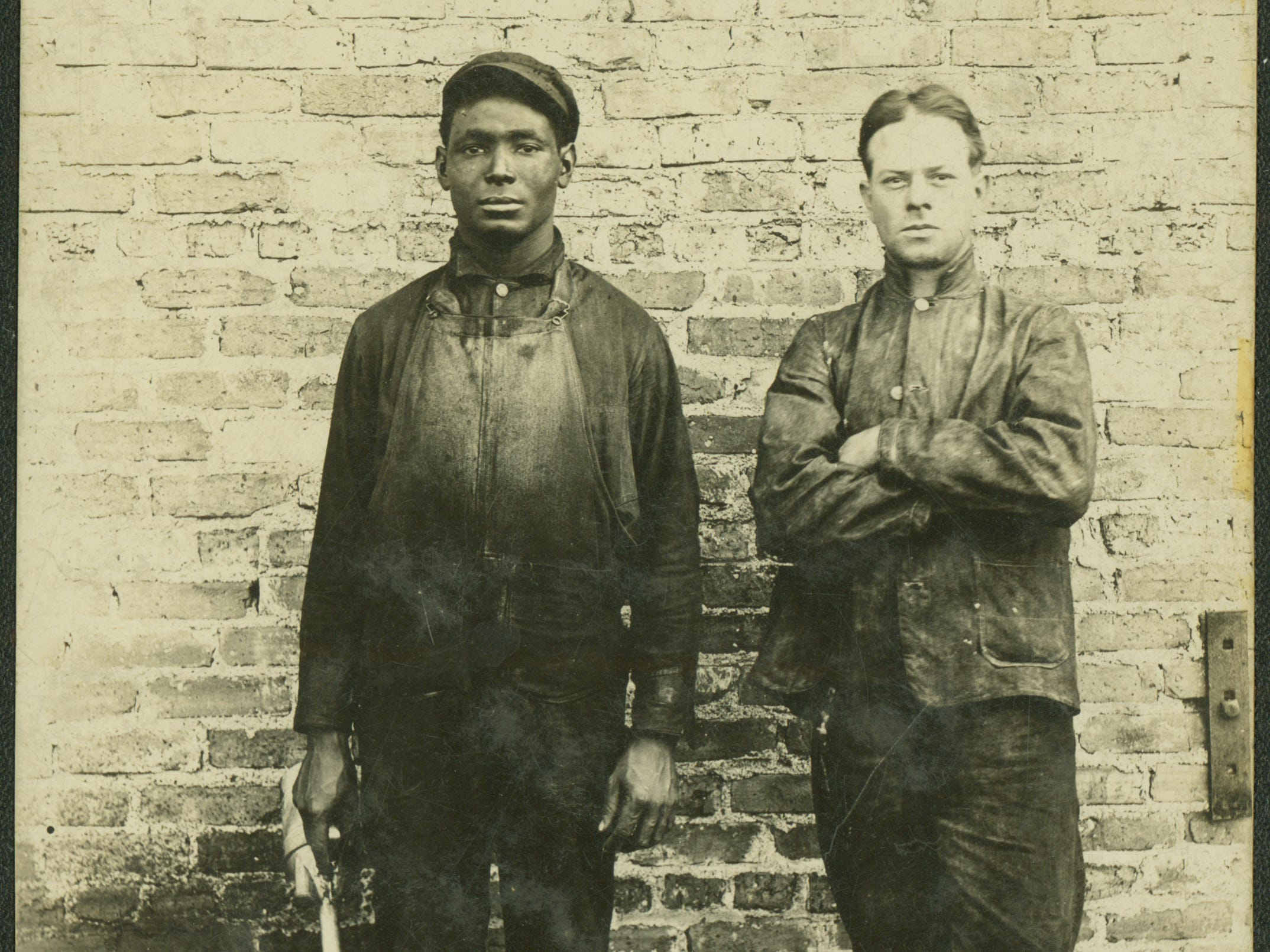 Two workers from Buxton in about 1910.