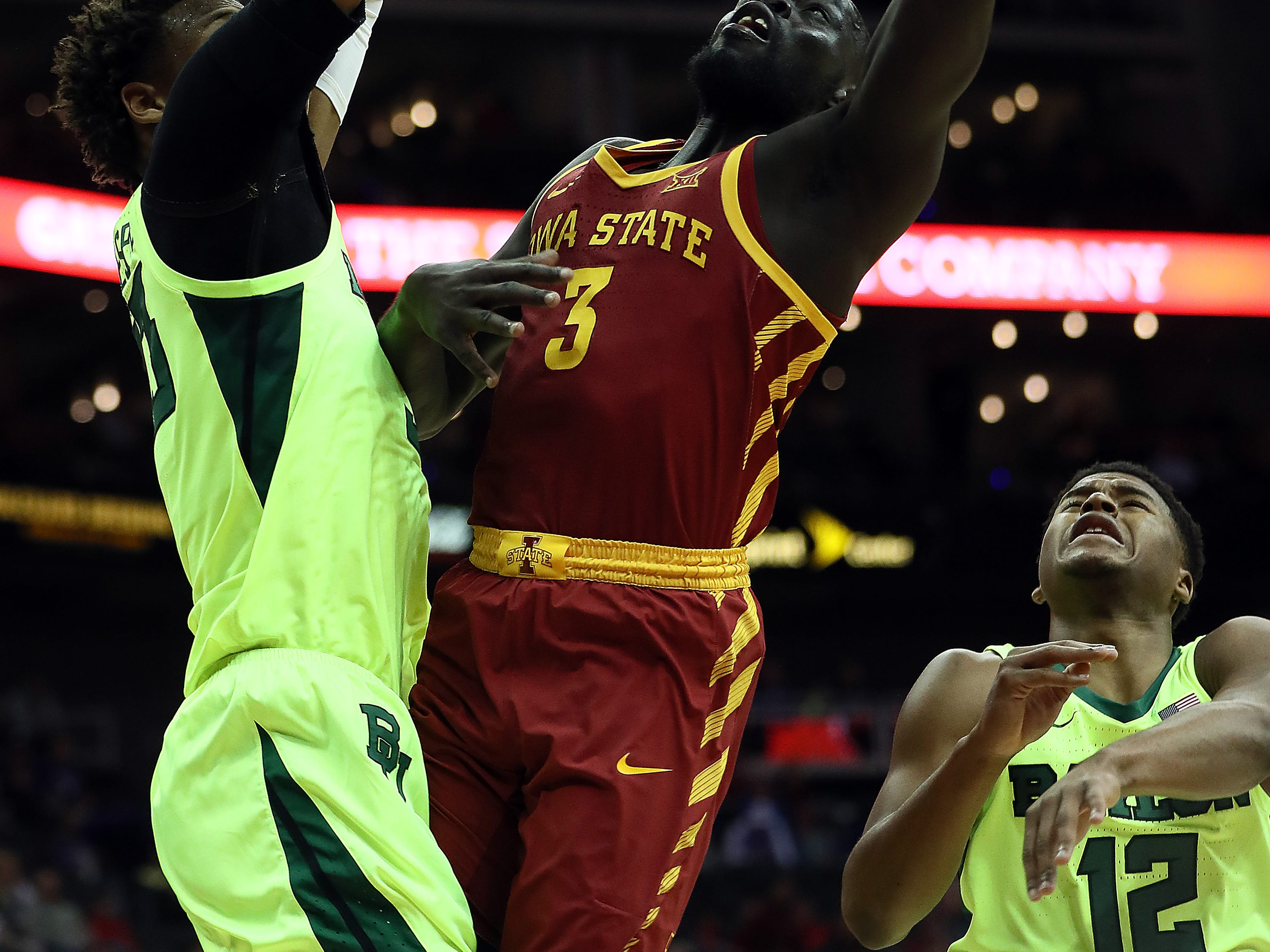 KANSAS CITY, MISSOURI - MARCH 14:  Marial Shayok #3 of the Iowa State Cyclones shoots over Freddie Gillespie #33 of the Baylor Bears during the quarterfinal game of the Big 12 Basketball Tournament at Sprint Center on March 14, 2019 in Kansas City, Missouri. (Photo by Jamie Squire/Getty Images)