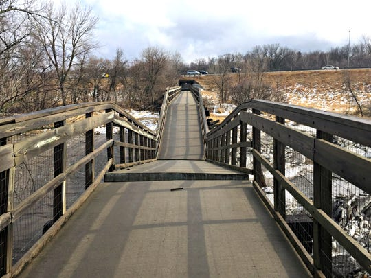 The Trestle Trail Bridge in Johnston collapsed Wednesday. The bridge is part of a bike trail located along the former Inter-Urban rail line that passes beneath Interstate Highway 35/80.