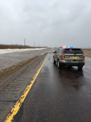An Iowa State Patrol vehicle is parked Wednesday, March, 14, 2019, on Highway 75, between Hinton and Cherokee, near where water has started to climb atop the road.