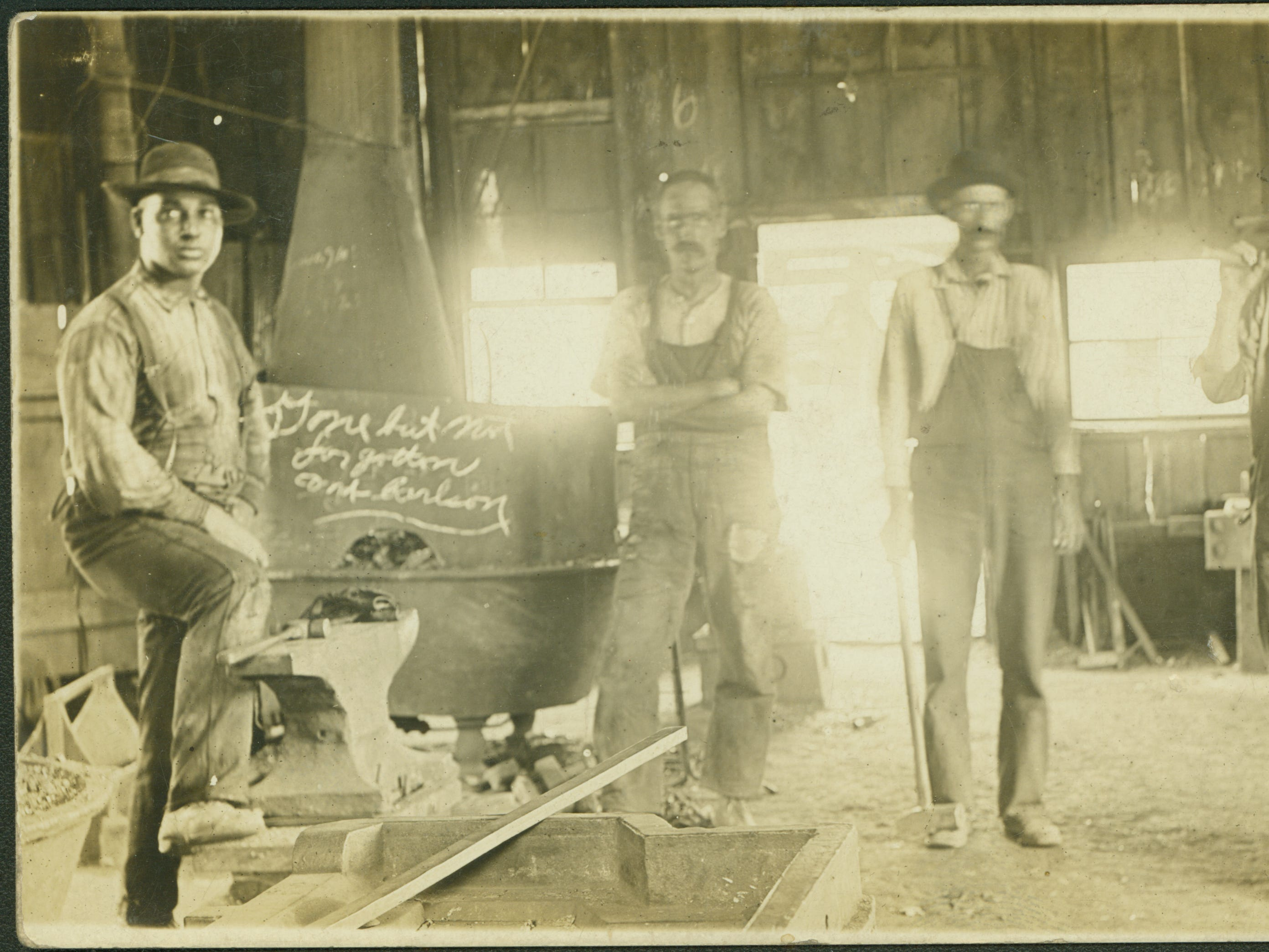 Employees at a blacksmith shop in Buxton, Iowa, about 1910. The town was known as a place where black migrants from the South worked side-by-side with white immigrants from Europe.