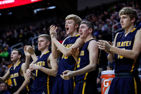 The Pewamo-Westphalia bench cheers for its teammates against Erie-Mason during the second half of MHSAA Division 3 semifinal at the Breslin Center in East Lansing, Thursday, March 14, 2019.