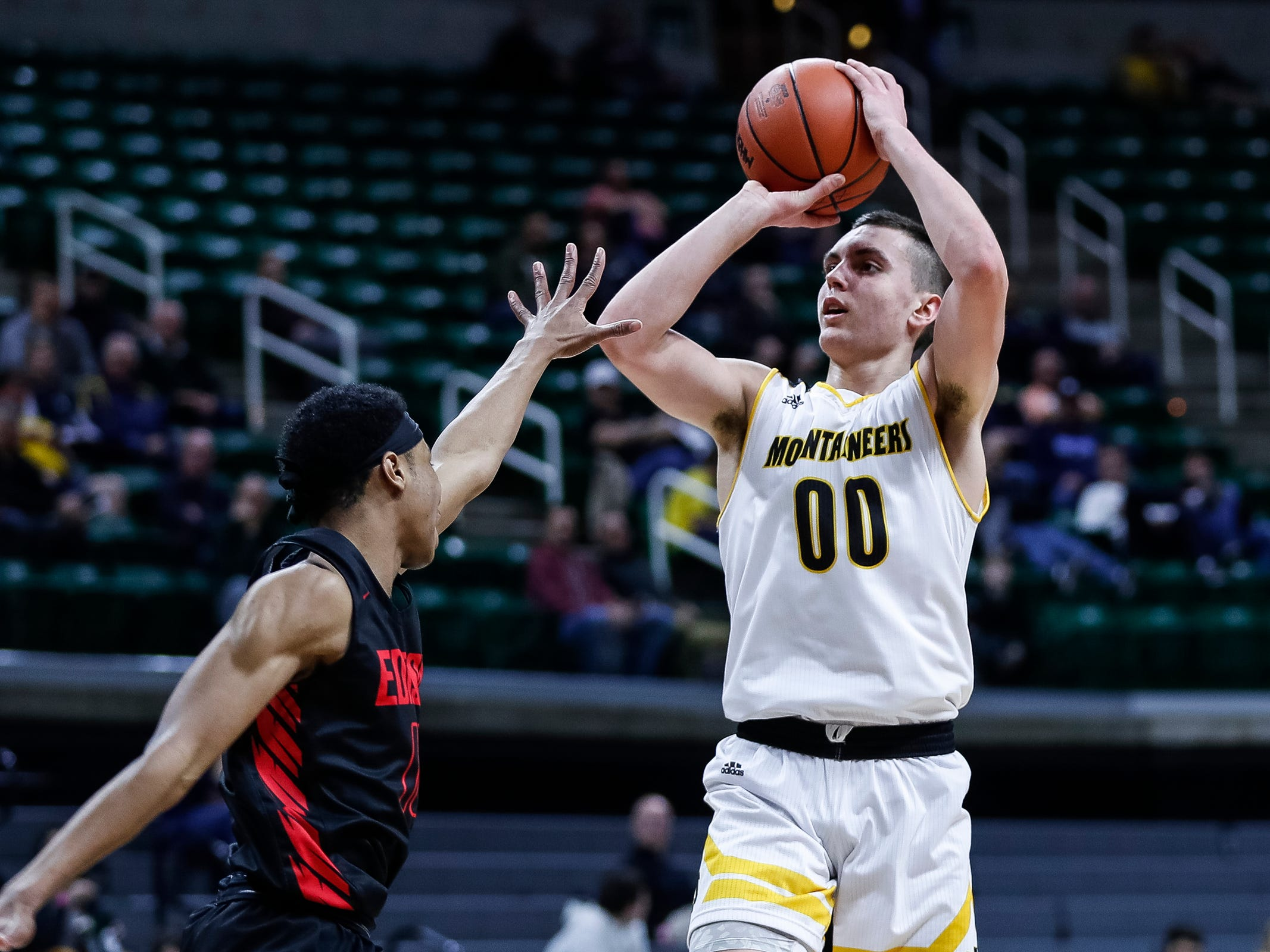 Iron Mountain's Foster Wonders shoots against Detroit Edison during the first half of MHSAA Division 3 semifinal at the Breslin Center in East Lansing, Thursday, March 14, 2019.