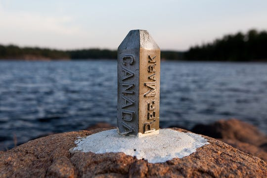 Border monument in Minnesota's Boundary Waters.