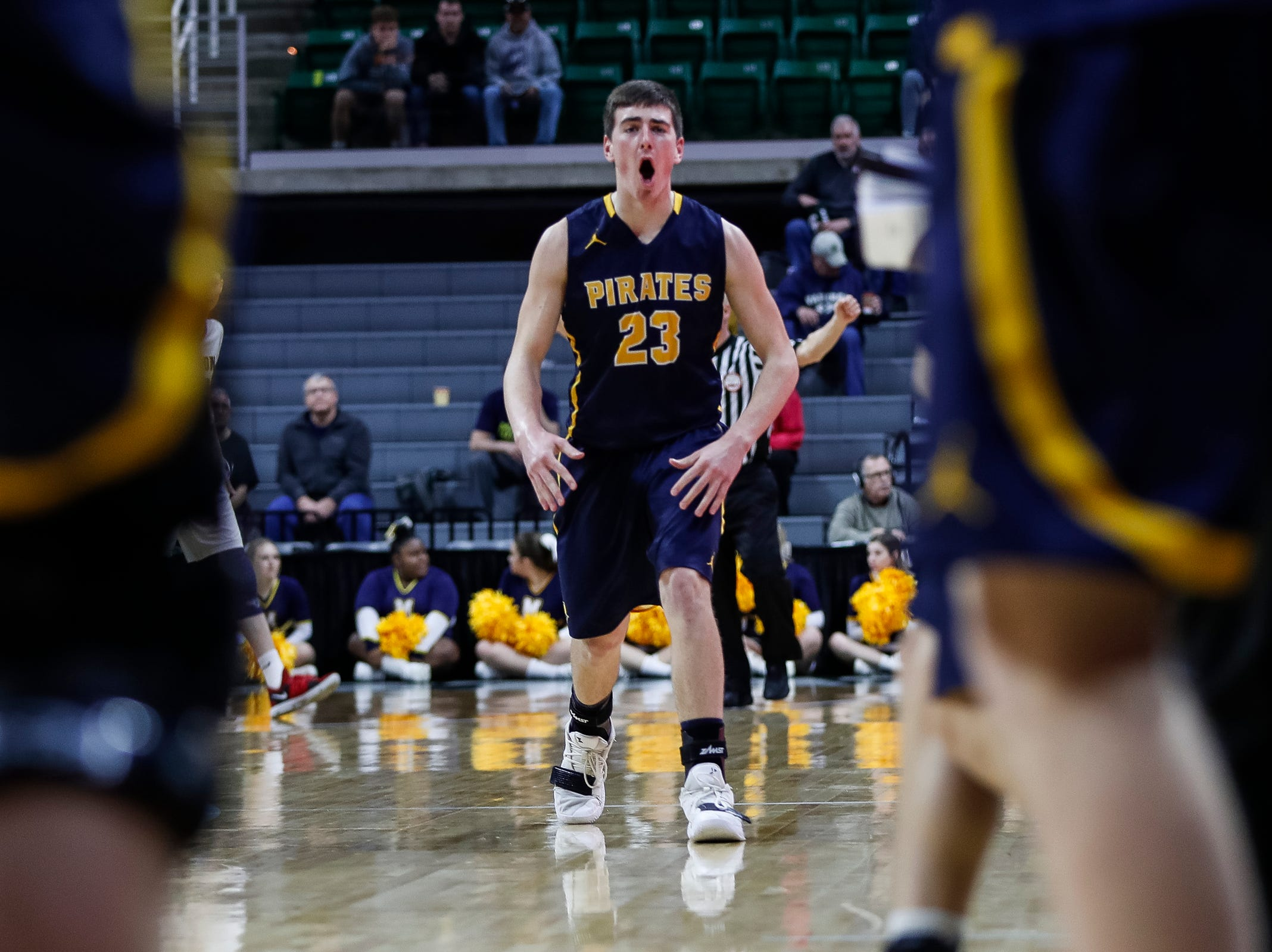 Pewamo-Westphalia's Aaron Bearss (23) celebrates after making a 3-pointer against Erie-Mason during the first half of MHSAA Division 3 semifinal at the Breslin Center in East Lansing, Thursday, March 14, 2019.