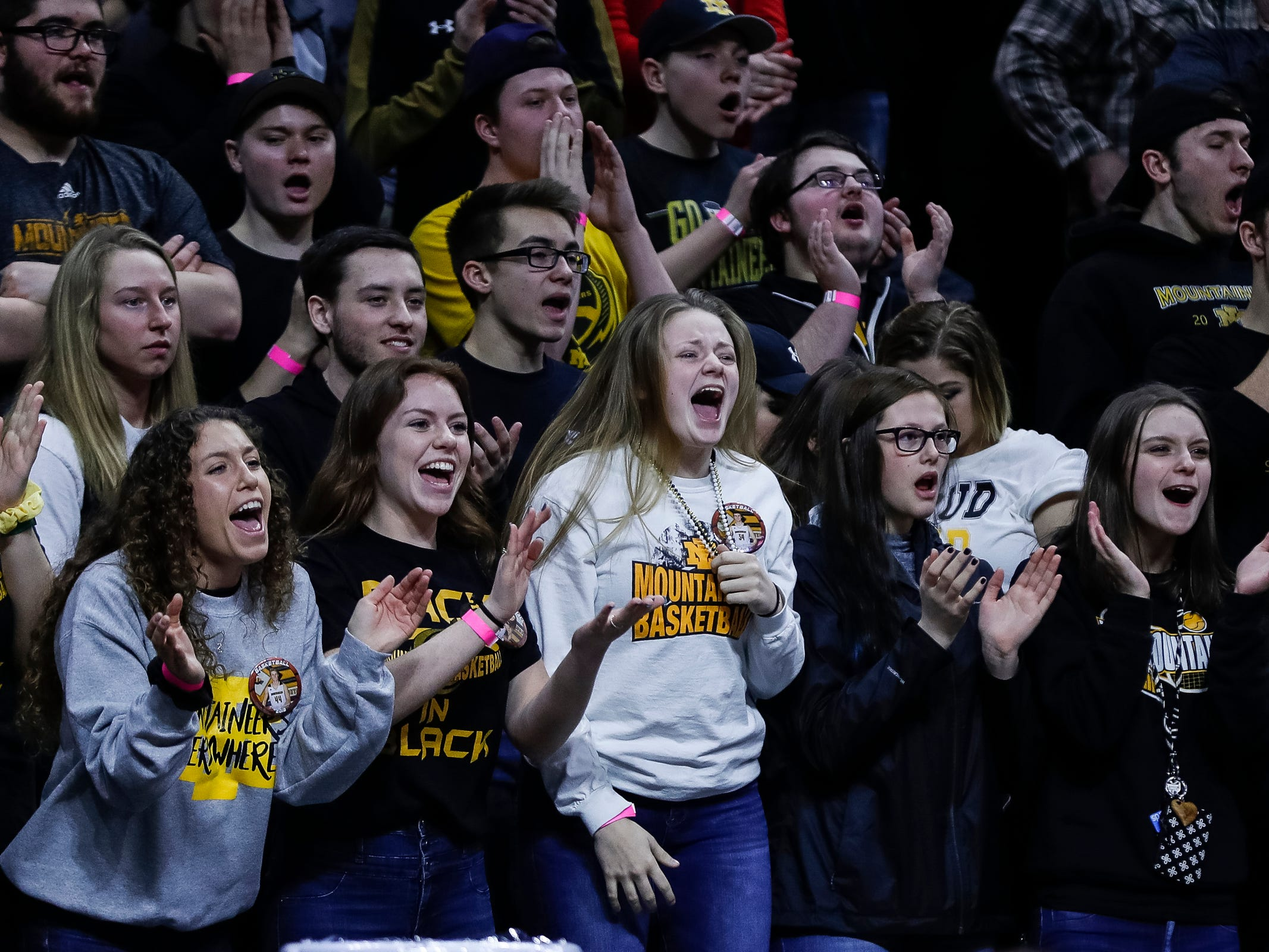 Iron Mountain students cheer for the Mountaineers during the first half of MHSAA Division 3 semifinal against Detroit Edison at the Breslin Center in East Lansing, Thursday, March 14, 2019.