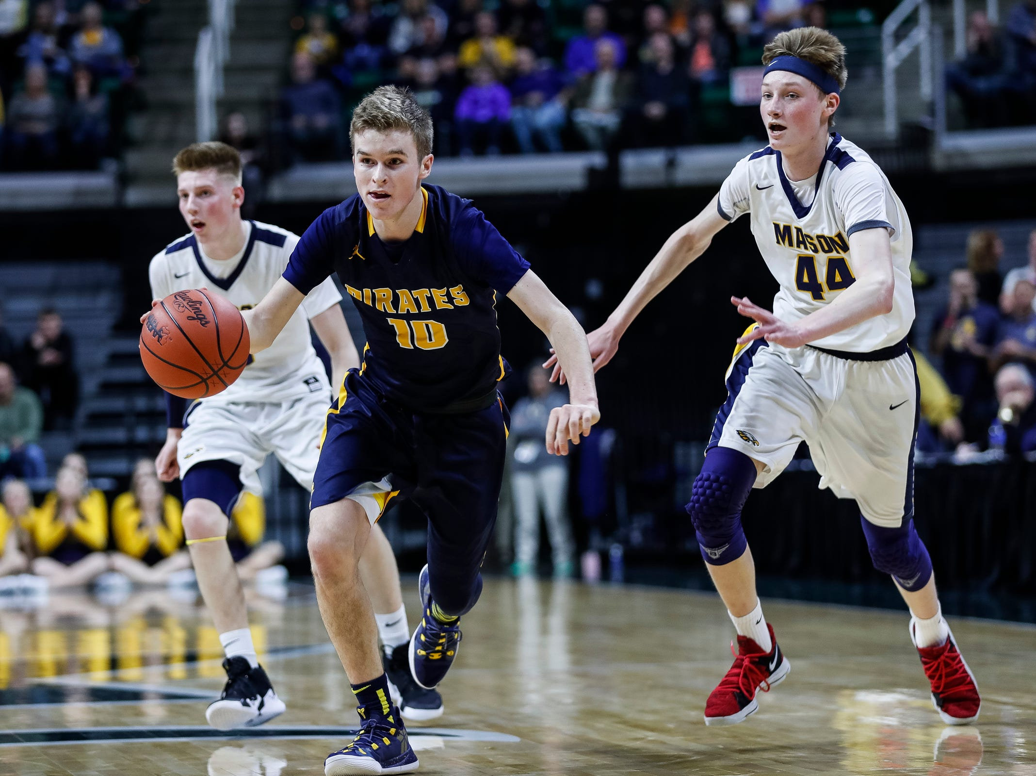 Pewamo-Westphalia's Hunter Hengaesbach (10) dribbles against Erie-Mason's John Sweeney (44) during the first half of MHSAA Division 3 semifinal at the Breslin Center in East Lansing, Thursday, March 14, 2019.