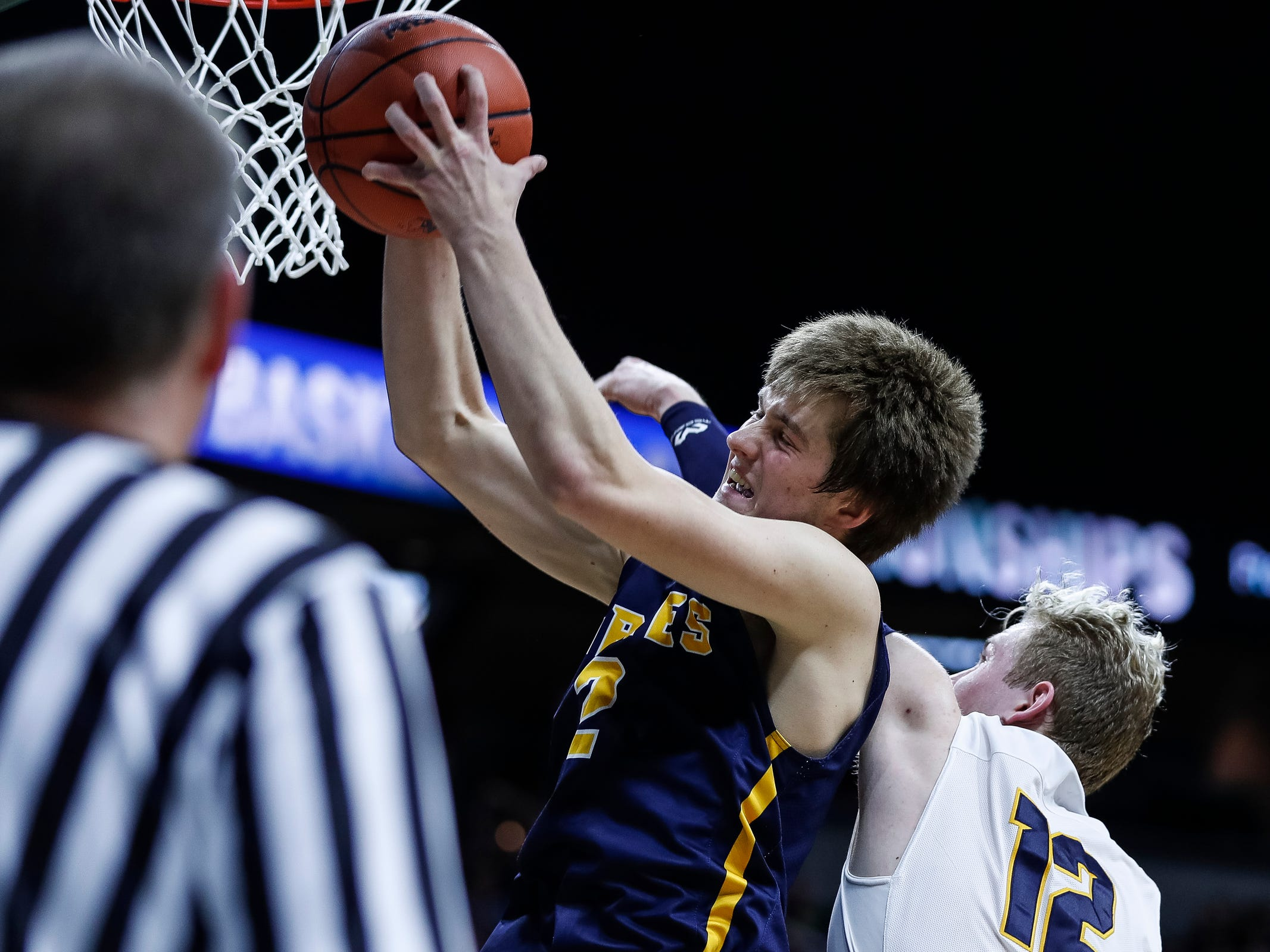 Pewamo-Westphalia's Nathan Wirth (2) battles for a rebound against Erie-Mason's Willie Werner (12) during the second half of MHSAA Division 3 semifinal at the Breslin Center in East Lansing, Thursday, March 14, 2019.