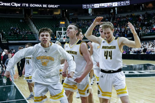 Iron Mountain players celebrate their 60-57 win over Detroit Edison during the MHSAA Division 3 semifinal at Breslin Center in East Lansing, Thursday, March 14, 2019.