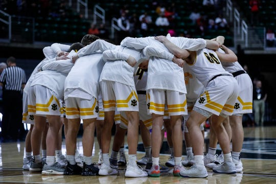 Iron Mountain players huddle before the first half of the MHSAA Division 3 semifinal against Detroit Edison at the Breslin Center in East Lansing, Thursday, March 14, 2019.
