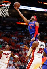 Detroit Pistons guard Bruce Brown (6) shoots against Miami Heat forward Justise Winslow (20) and guard Josh Richardson (0) during the first half of an NBA basketball game, Wednesday, March 13, 2019, in Miami.