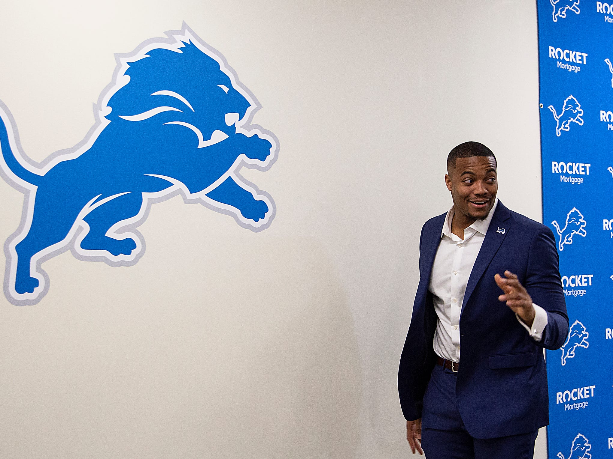 New Lions defensive end Trey Flowers waves to the media Thursday, March 14, 2019 after a news conference at the practice facility in Allen Park.