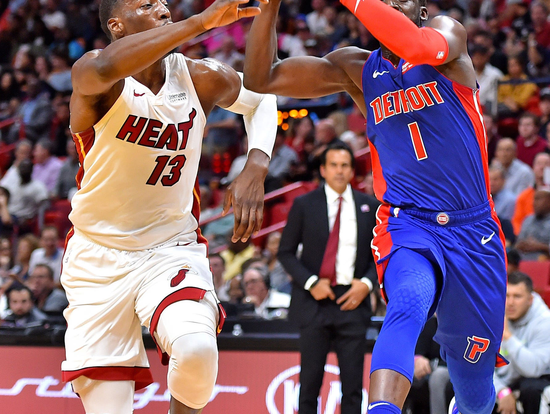 Detroit Pistons guard Reggie Jackson (1) drives to the basket as Miami Heat center Bam Adebayo (13) defends during the second half at American Airlines Arena on Wednesday, March 13, 2019.
