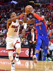 Detroit Pistons guard Reggie Jackson drives to the basket as Miami Heat center Bam Adebayo defends during the second half at American Airlines Arena on Wednesday, March 13, 2019.