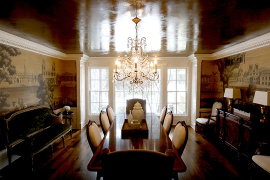 In a house where nearly everything is custom, the dining room murals in this home on Glengarry in Bloomfield Hills were painted in Europe by an artist also working for Britain's Queen Elizabeth. The reflective plaster ceiling was created by a craftswoman who worked on site.