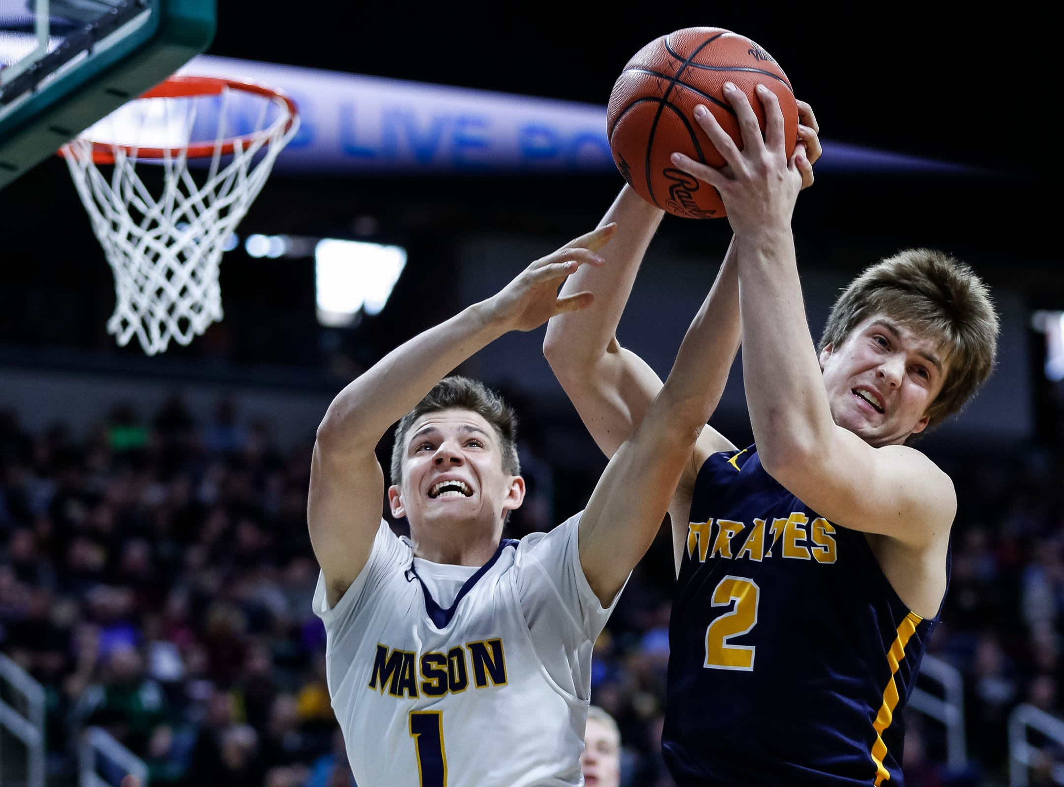 Erie-Mason's Joe Liedel (1) and Pewamo-Westphalia's Nathan Wirth (2) battle for a rebound during the first half of MHSAA Division 3 semifinal at the Breslin Center in East Lansing, Thursday, March 14, 2019.