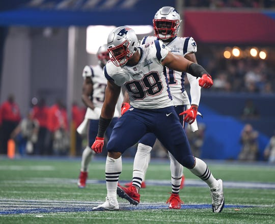 New England Patriots defensive end Trey Flowers celebrates during the fourth quarter against the Los Angeles Rams in Super Bowl LIII on Feb. 3, 2019.