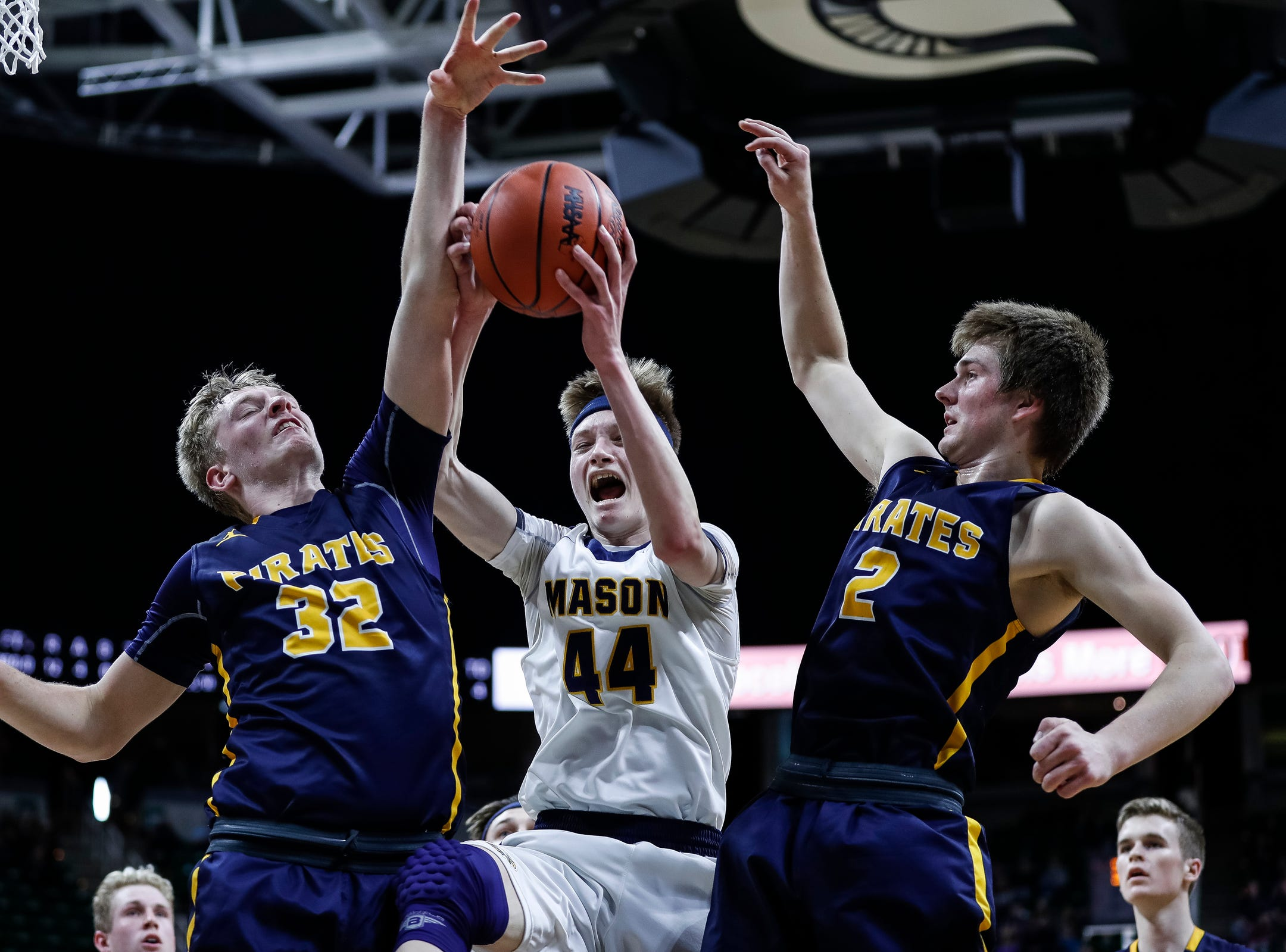 Erie-Mason's John Sweeney (44) battles for a rebound against Pewamo-Westphalia's Andre Smith (32) and Nathan Wirth (2) during the first half of MHSAA Division 3 semifinal at the Breslin Center in East Lansing, Thursday, March 14, 2019.