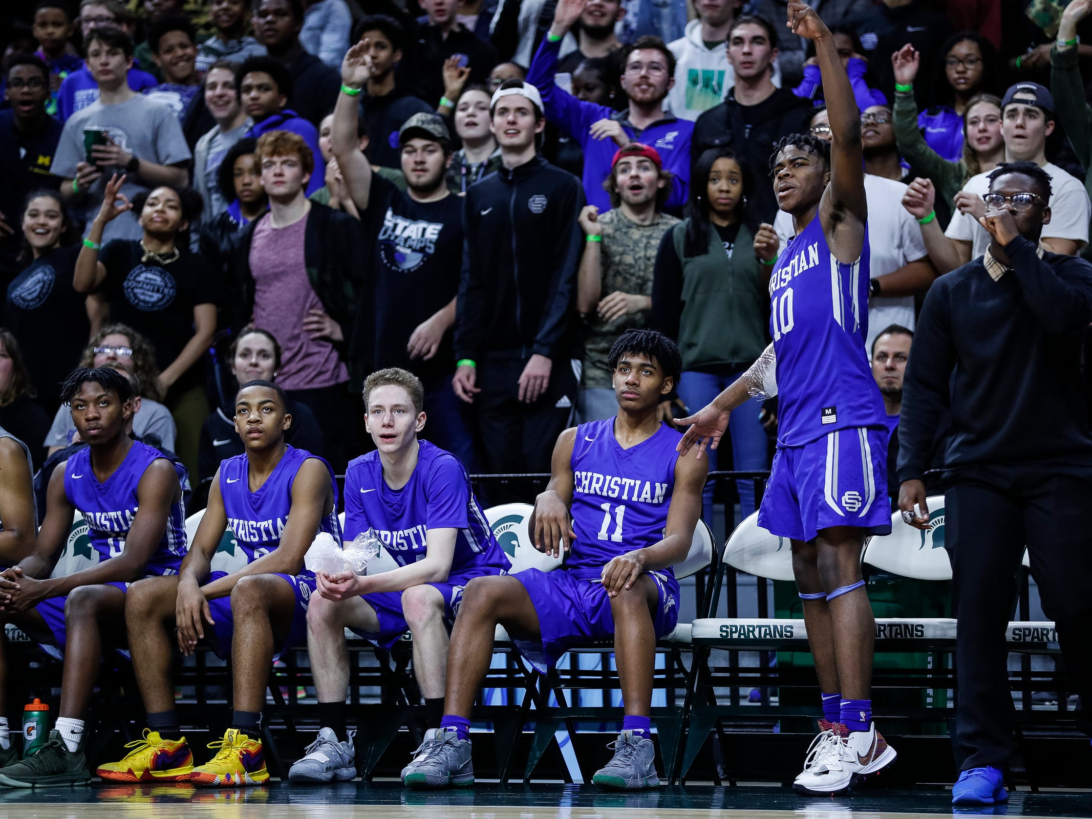 Southfield Christian bench cheer for their teammates during the second half of MHSAA Division 4 semifinal against Dollar Bay at the Breslin Center in East Lansing, Thursday, March 14, 2019.