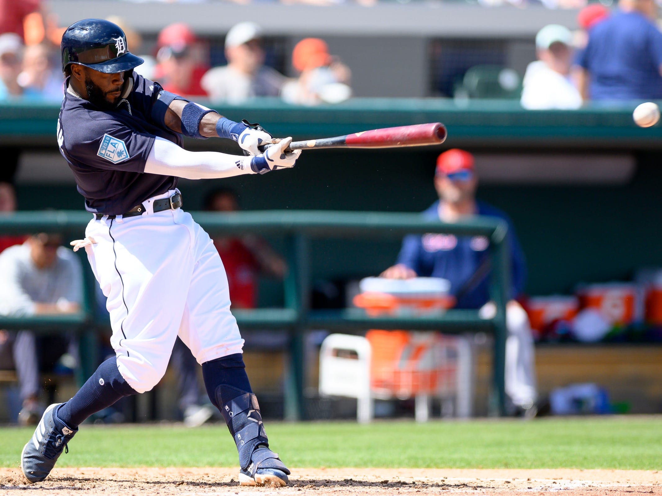 Detroit Tigers infielder Josh Harrison singles to left field during the fifth inning against the Boston Red Sox at Joker Marchant Stadium in Lakeland, Fla. on March 14, 2019.