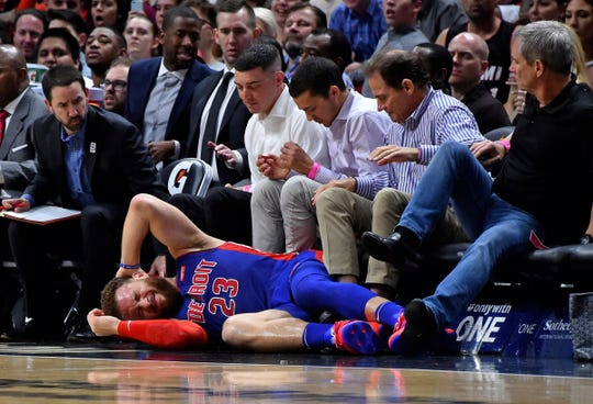 Detroit Pistons forward Blake Griffin (23) lays on the court after being injured during the first half against the Miami Heat at American Airlines Arena on March 13, 2019.