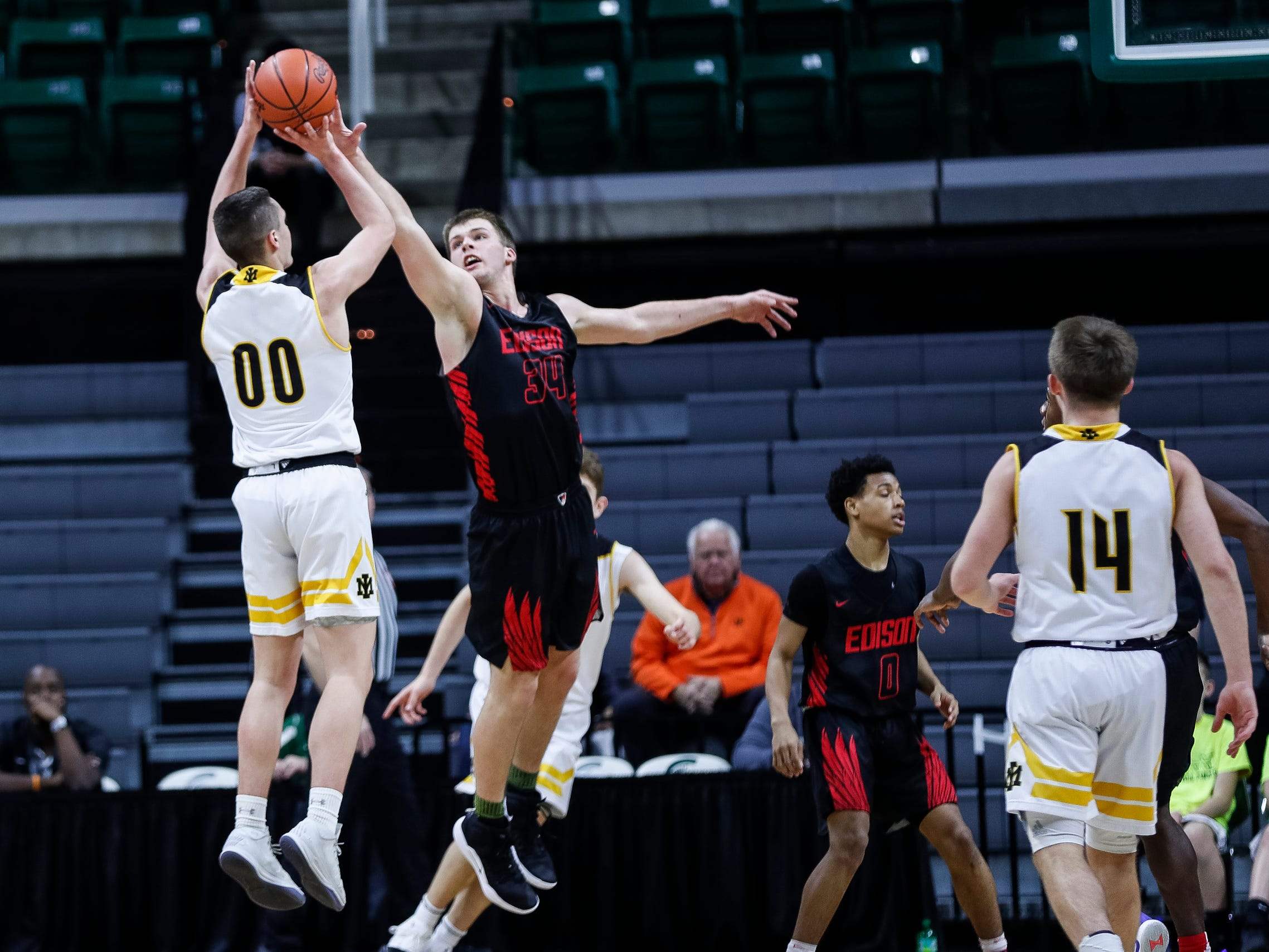 Iron Mountain's Foster Wonders (00) shoots against Detroit Edison's Bryce George (34) during the first half of MHSAA Division 3 semifinal at the Breslin Center in East Lansing, Thursday, March 14, 2019.