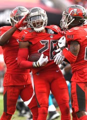 Buccaneers defensive back Andrews Adams (26) celebrates an interception in the second half against the Panthers at Raymond James Stadium, Dec. 2, 2018.