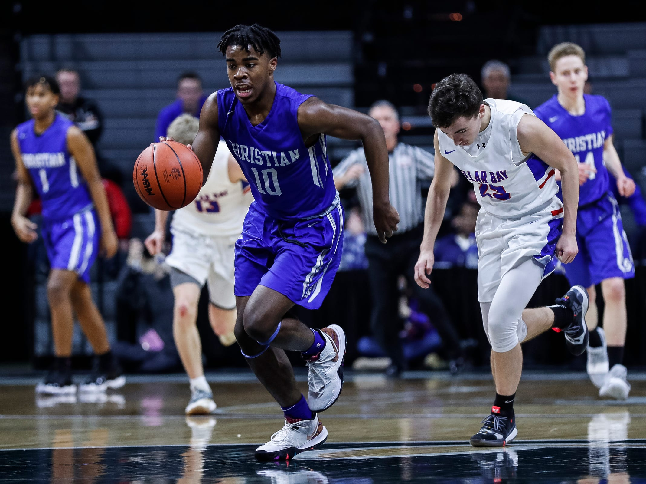 Southfield Christian's Jon Sanders (10) dribbles against Dollar Bay during the first half of MHSAA Division 4 semifinal at the Breslin Center in East Lansing, Thursday, March 14, 2019.